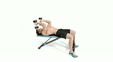A fitness trainer performing the lying dumbbell triceps extension