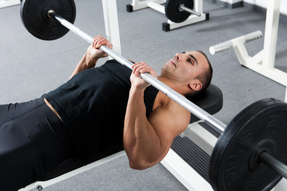 Fitness trainer performing the close grip bench press exercise