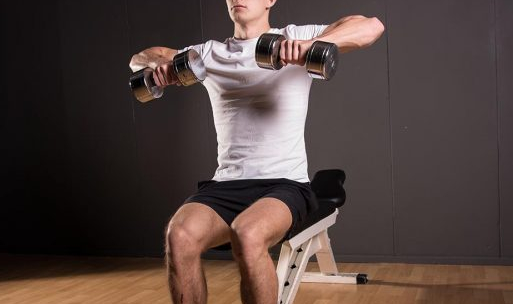 Doing seated rows with dumbbells